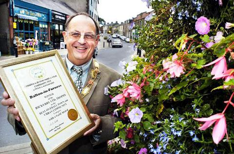 Mayor Barry Doughty shows off one of Dalton's certificates