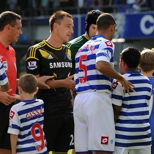 Mark Hughes was unaware which of his QPR players would snub John Terry, second left, in the clash with Chelsea