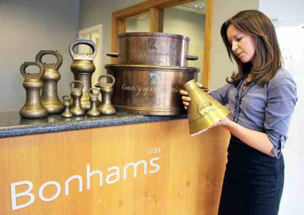 Megan Wheeler of Bonhams inspecting some of the items