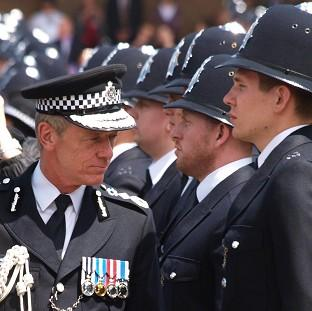 Met chief Bernard Hogan-Howe, seen inspecting newly-graduated officers, says the force is committed to frontline policing despite cuts