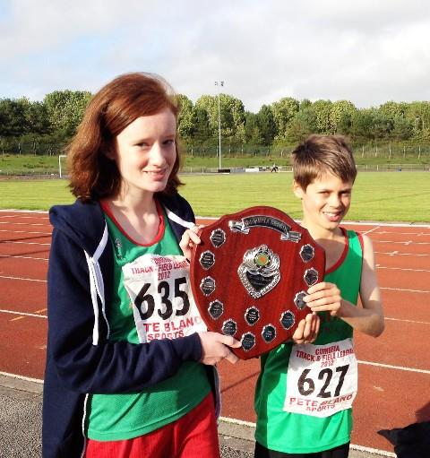 Amy Wood and Josh Hayes hold the U13 team trophy awarded to Kendal AC