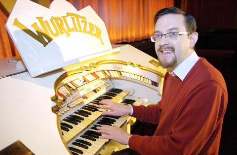 Mark Latimer tries out the vintage 1920s Wurlitzer organ