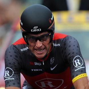 Tyler Hamilton is one of Lance Armstrong's, pictured, former US Postal Service Pro Cycling team-mates