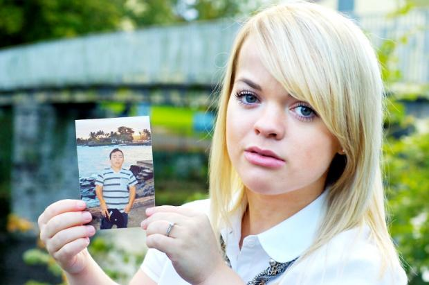 Sophie Renwick with a photograph of her fiance Anthony Arvizu, who lives in California.