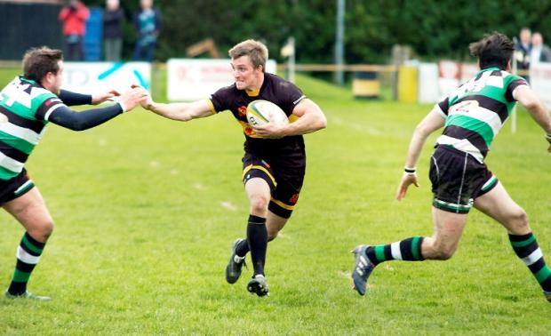 Full back Chris Park, kicker of all Kendal's points, breaks out of defence in the 24-15 loss to Lymm