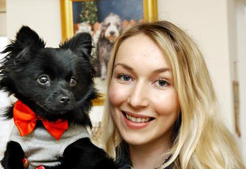 Shop owner Charlotte Ronald and pampered puppy Arnold