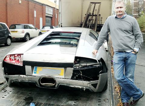 Owner Stephen Leahy with his damaged Lamborghini