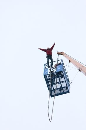 Donald Potter plunges from a crane over a lake at Tatton Park, Cheshire, for charity
