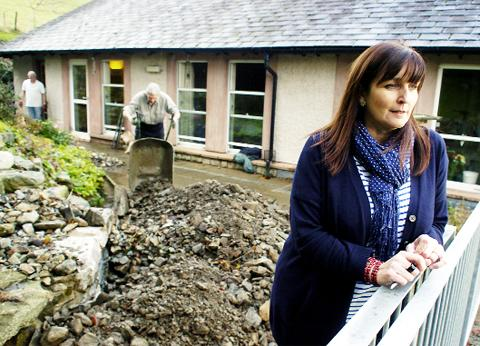 Sue McGraw at a rubble-strewn St Mary's Hospice