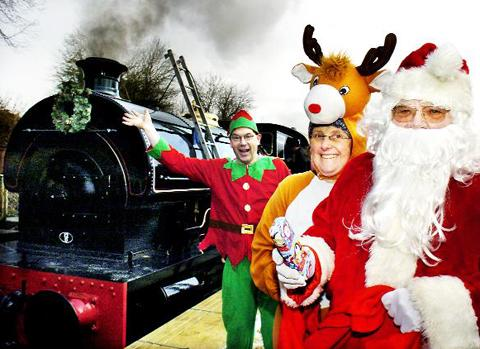 Volunteer Elf Mark Keefe, Reindeer Sue Jones and Santa ready to leave Kirkby Stephen East Station