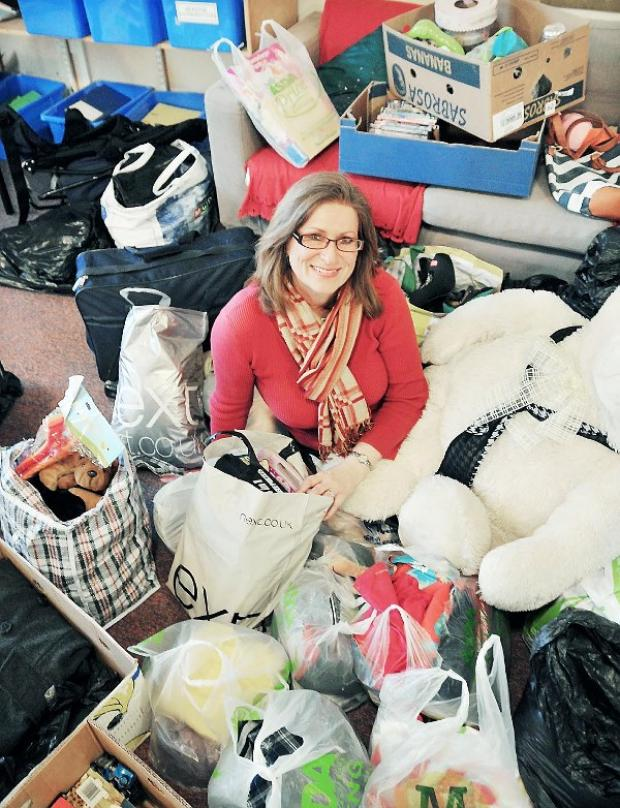 The Westmorland Gazette: Castle Park Primary School headteacher Helen Richardson with the toys and clothes generously donated by parents and residents