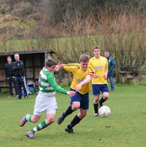 Kendal United (yellow) on the attack against their town rivals Celtic (green and white). Picture by Richard Edmondson