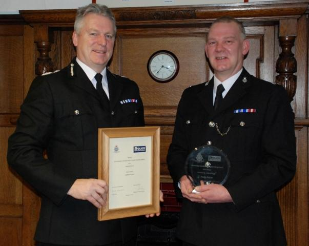 PC Andy Ivison (right) and temporary chief constable Bernard Lawson (left)