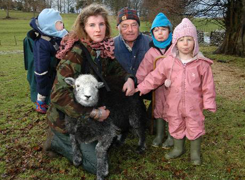 The Owen family with shepherd Alex Baines and one of the sheep at Sandwath Farm