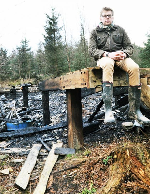 Tim Sands at the remains of his hut