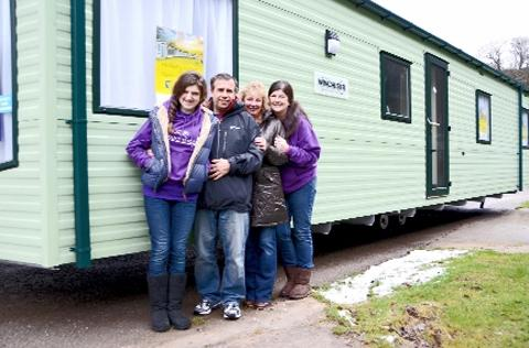 The Winchester Willerby caravan being handed over by Alice's sister Milly and mum and dad to Gillian Varley, co-owner of Bardsea Leisure Park (third left)