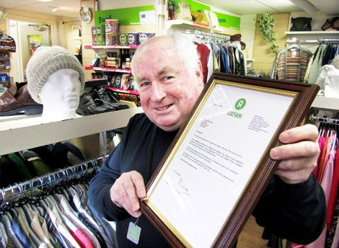 Oxfam volunteer Barrie Wendt with his International Oxfam Person of the Year award