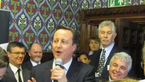 The Westmorland Gazette: Prime Minister David Cameron addresses a packed room as part of Cumbria Day watched on by Ian Stephens of Cumbria Tourism (right)
