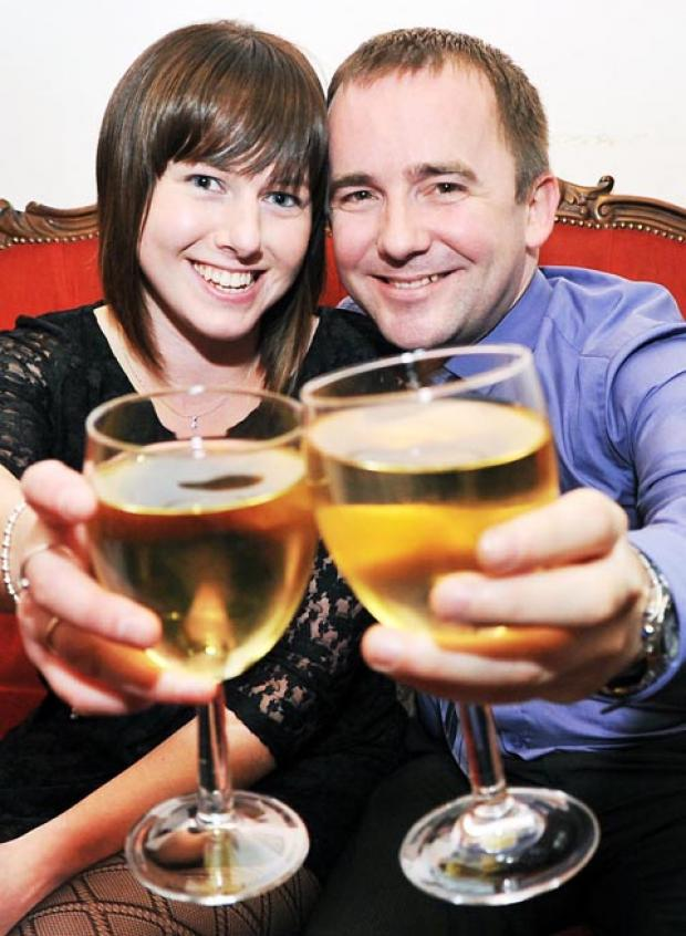 Laura and David toast their engagement