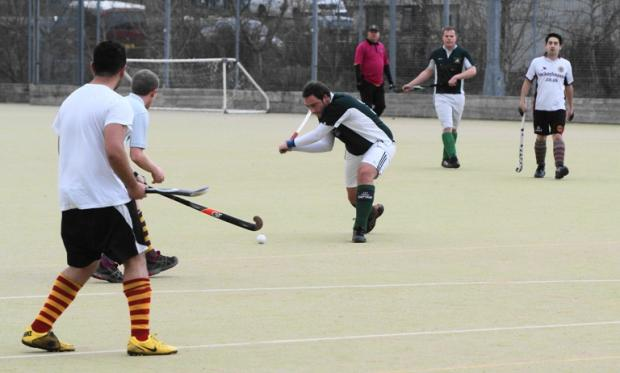 Kendal captain Nick Davis shoots and scores against Mossley Hill. Picture by Richard Edmondson