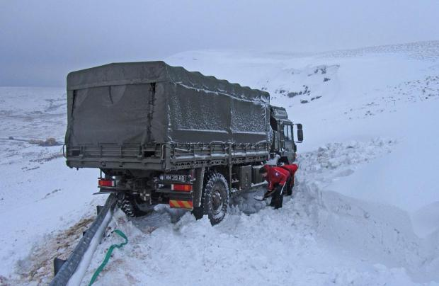 The army truck being dug out of the snow