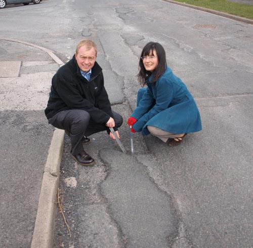 Tim with resident Jayne Richardson with one of the potholes on Kendal's Hayclose Road