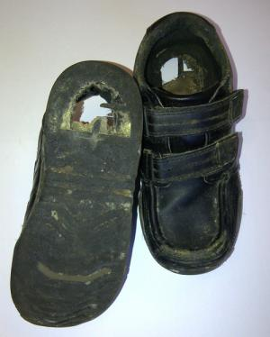 Battered and full of holes, the pair of shoes worn by an infant in Barrow and Furness