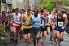 Wegene Tafese leads the pack in the senior men's Inter-Counties fell race. Photo by Dave Woodhead of woodentops.org.uk