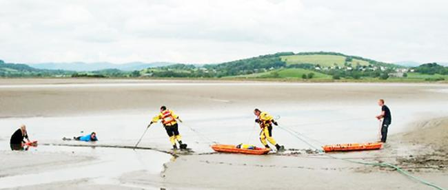 Rescuers begin the delicate job of making their way out to the couple trapped at Sandside