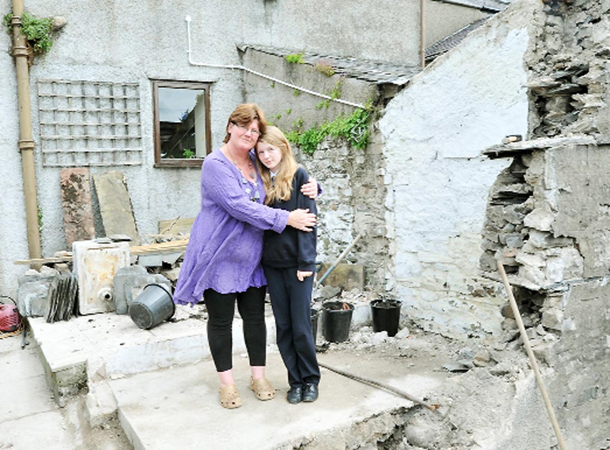 Bexi Hebbourn and mum Kay at the demolished building