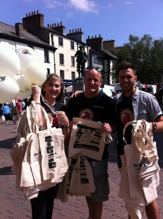 Gazette staff handing out goody-bags and balloons this morning