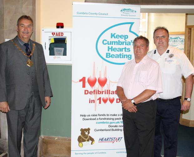 Coun Alan Barry (left) with Coun John Murphy (centre) and Barrow Fire station watch manager Mark Ducie who demonstrated how to use a defib at today's launch) is invalid.