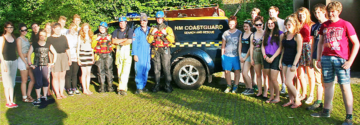 Young people from Dallam School, Milnthorpe, and Queen Elizabeth's School, Kirkby Lonsdale, on a visit to HM Coastguard at Arnside. The students are pictured with Station officer Nigel Capstick and Coastguard Andrew Pringle