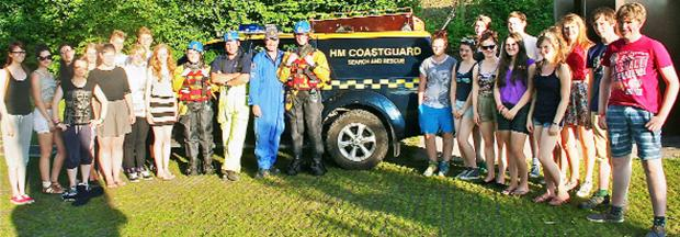 The Westmorland Gazette: Young people from Dallam School, Milnthorpe, and Queen Elizabeth's School, Kirkby Lonsdale, on a visit to HM Coastguard at Arnside. The students are pictured with Station officer Nigel Capstick and Coastguard Andrew Pringle