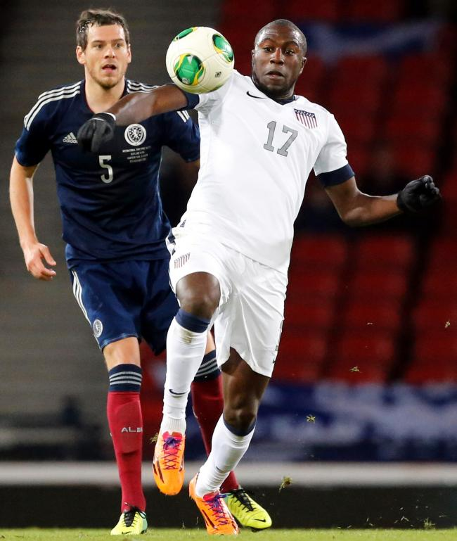 Gordon Greer tussles with USA striker Jozy Altidore