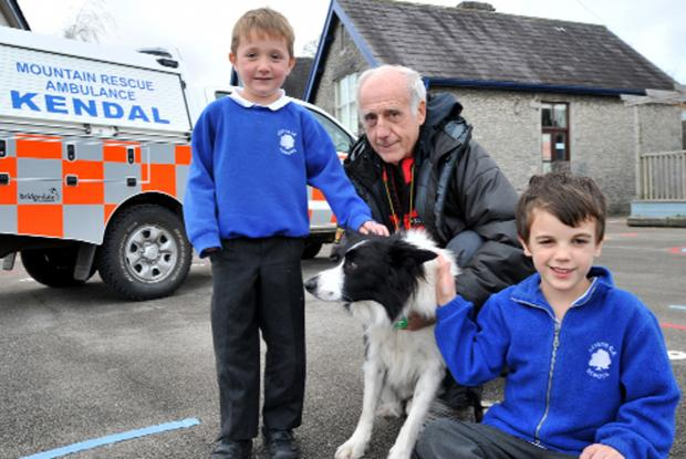 Bill Malone, rescue team medical officer and Ani the rescue dog with pupils Sam Duncan, five and Finn Houston, six