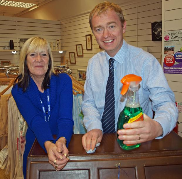 Mr Farron with Jackie Pow at the St John's Hospice shop in Kendal