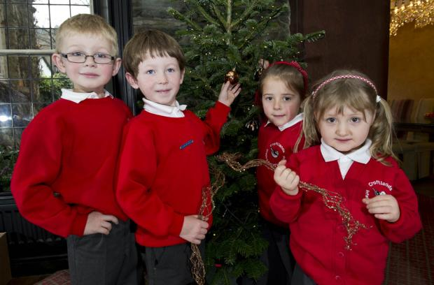 Croftlands Infant School winners enjoying a day at the Lakeside Hotel are, left to right, Daniel Jackson, Harry Struckman, Eve Armstrong and Rebecca Duckworth