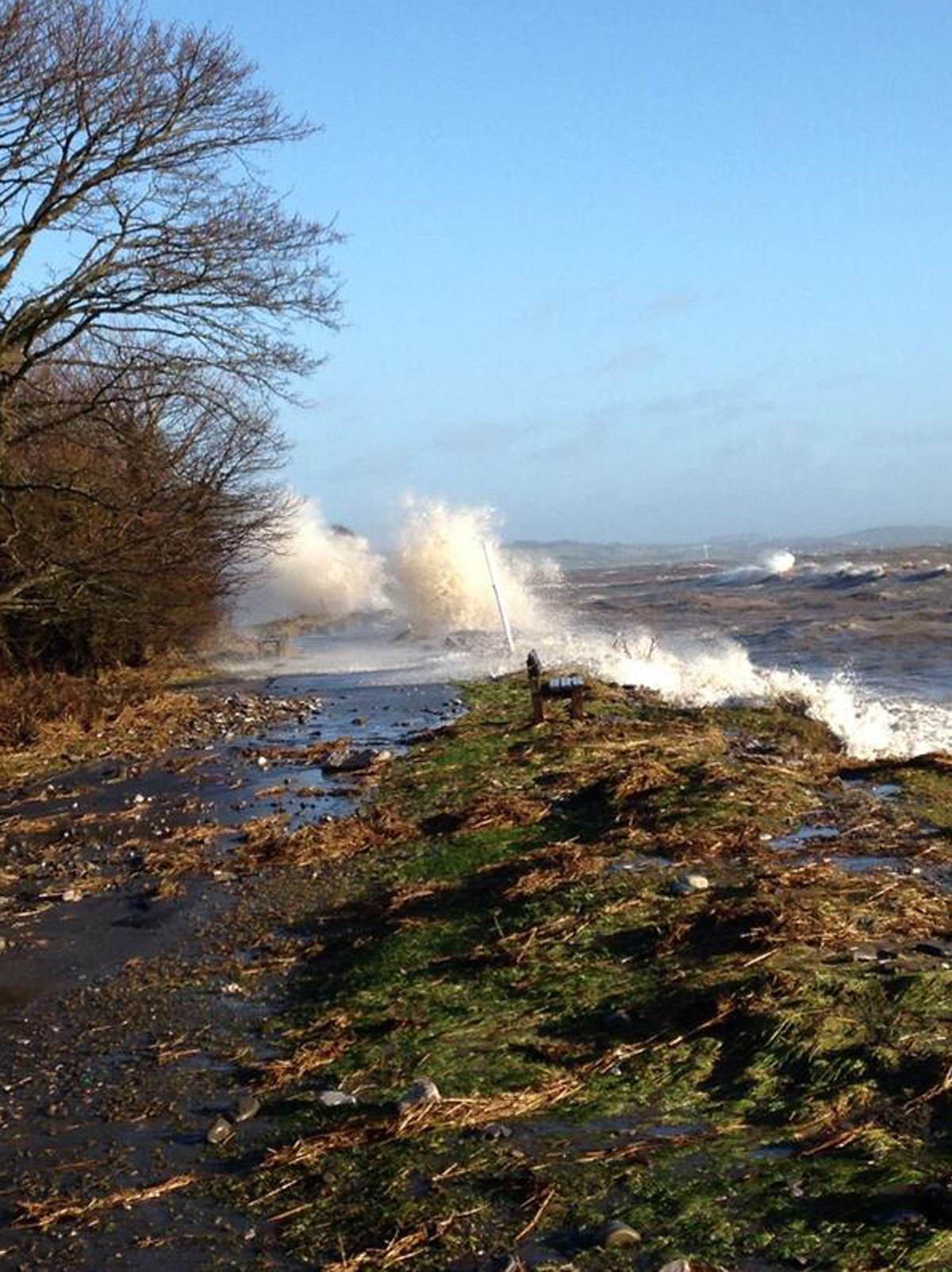 Police continue to warn people to stay away from seaside locations as high tide reaches height