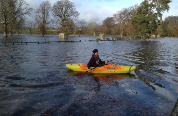 Emily Crowder as flood water swept through Levens Hall's car park