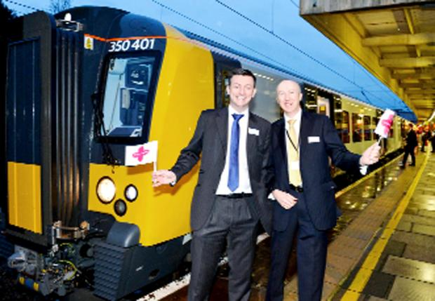 Chris Nutton and Nick Donovan  of First Transpennine Express ready to wave off the maiden voyage of the new electric train service from Manchester