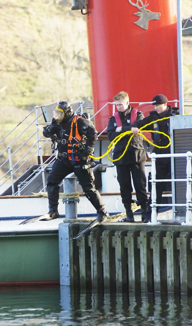 The Westmorland Gazette: A diver prepares to enter the water last week in the search for missing Thomas McMorrow