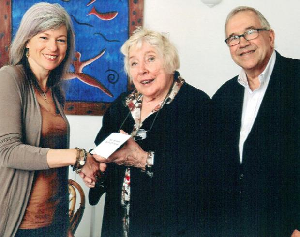 Annie receiving her latest prize from judges Fay Weldon and Simon Brett