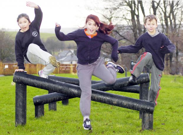 Pupils Daisy Schwarzer, Kelcie Berry and Liam Curry using the trail