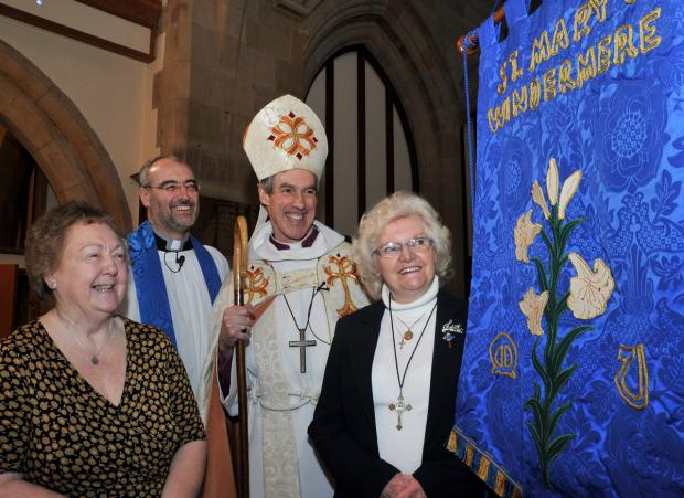 Pictured at church during the ceremony are MU branch leader Marie Wright, vicar, the Rev David Wilmot, the Rt Rev James Newcome and MU member and banner maker Patricia Platt