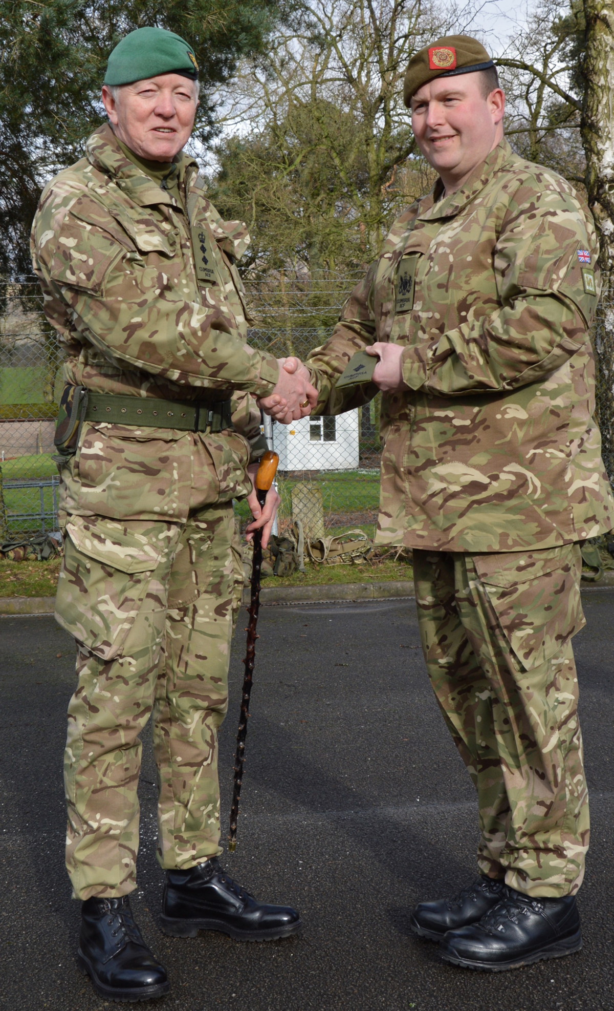 L-R Colonel Tom McMullen MBE, Commandant of Cumbria Army Cadet Force, presenting 2Lt