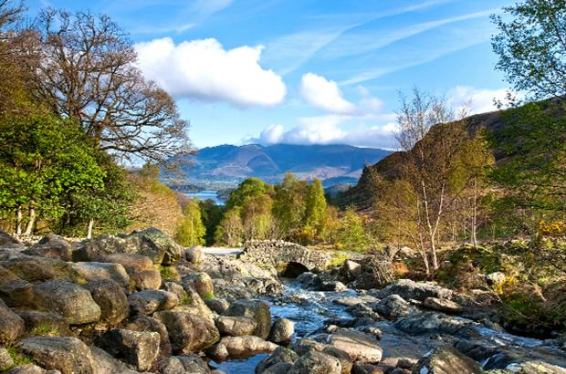 Ashness Bridge is set in the kind of stunning scenery that is helping to attract more tourists to the Lake District (Photograph by Nina Claridge)