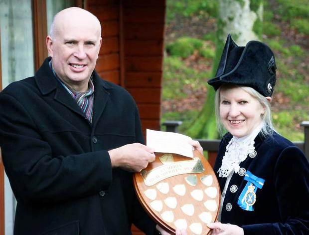 High Sheriff Diana Matthews presents the shield to the Brathay Exploration Group's Malcolm Tillyer