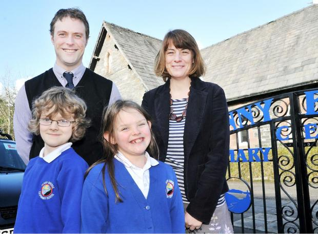 Headteacher Lynn Smolinski and deputy Graham Carrick with pupils Henry Bangham and Jess Evans