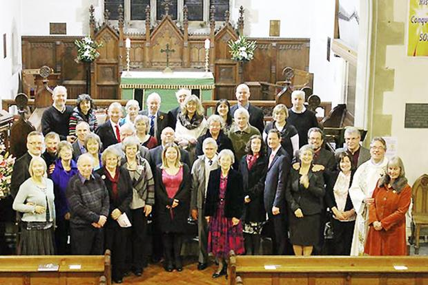 Couples who joined the Rev Tim Harmer for the record bid service at St Andrew's Church, Coniston
